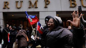 Demonstrators protesting against U.S. President Donald Trump's recent statements about immigration and Haiti chant in front of a Trump building in New York, U.S., January 19, 2018.  REUTERS/Lucas Jackson