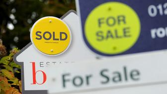 Embargoed to 0001 Monday December 11 File photo dated 14/10/14 of Sold and For Sale signs. House sellers' asking prices plunged by more than £8,000 month on month on average in December, according to a property website.