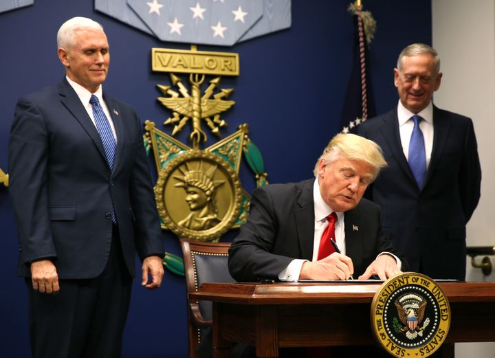 President Donald Trump signs the first ban, Jan. 27, 2017. It barred travel from Muslim-majority countries for 90 days,