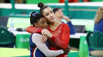 2016 Rio Olympics - Artistic Gymnastics - Final - Women's Individual All-Around Final - Rio Olympic Arena - Rio de Janeiro, Brazil - 11/08/2016. Simone Biles (USA) of USA (L) and Alexandra Raisman (USA) of USA (Aly Raisman) hug as they await their scores during the women's individual all-around final. Biles and Raisman won gold and silver respectively. REUTERS/Mike Blake FOR EDITORIAL USE ONLY. NOT FOR SALE FOR MARKETING OR ADVERTISING CAMPAIGNS.