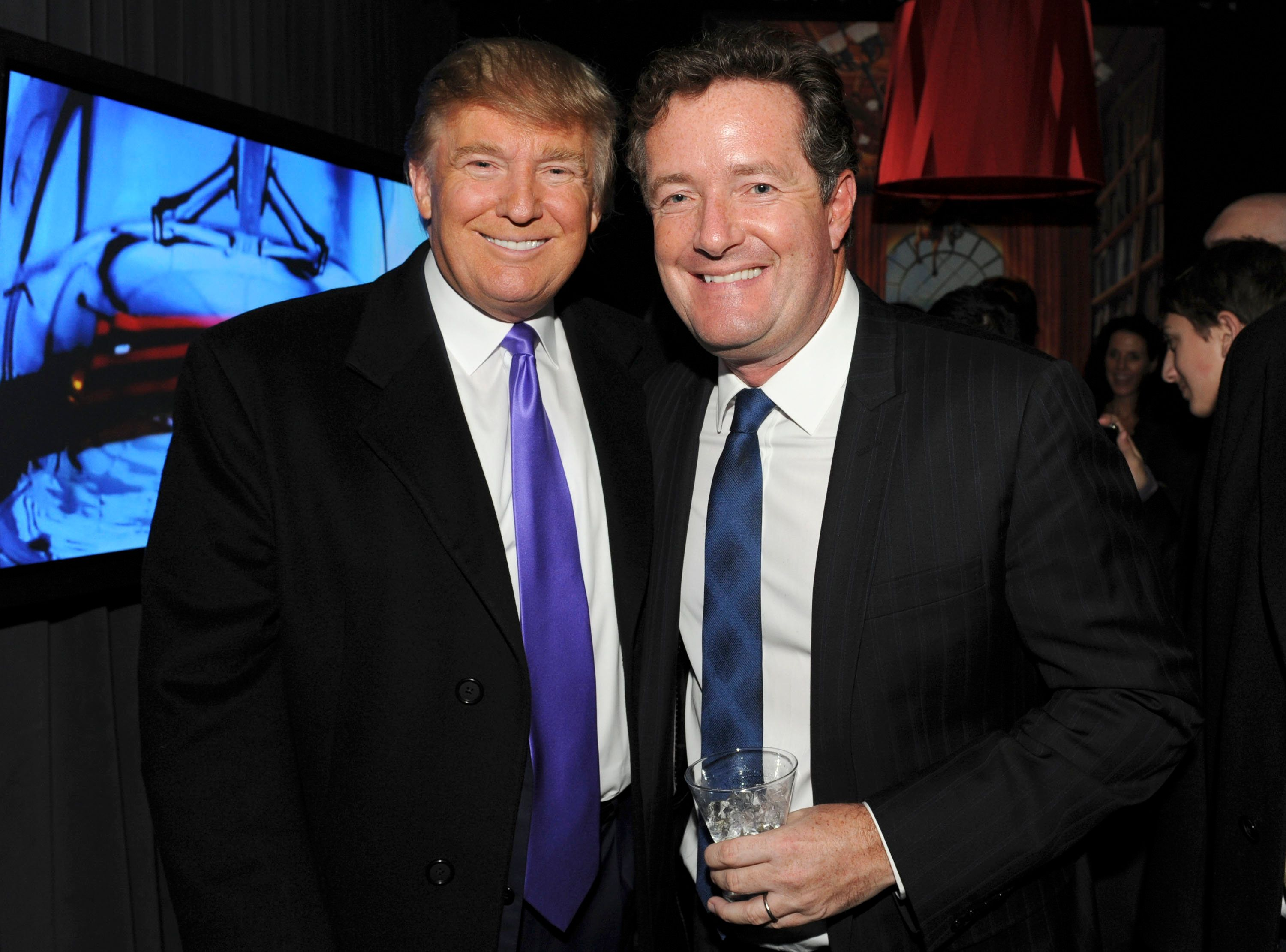 NEW YORK - NOVEMBER 10: Television Personality Donald Trump and journalist Piers Morgan attend the celebration of Perfumania and Kim Kardashian�s appearance on NBC�s 'The Apprentice' at the Provocateur at The Hotel Gansevoort on November 10, 2010 in New York, New York.  (Photo by Mathew Imaging/WireImage)