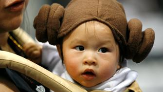 "Eleven-month old Jada Chow wears a Princess Leia costume during the opening day of ""Star Wars Celebration IV"" in Los Angeles May 24, 2007. The five-day convention celebrates the 30th anniversary of the Star Wars saga. REUTERS/Mario Anzuoni (UNITED STATES)"