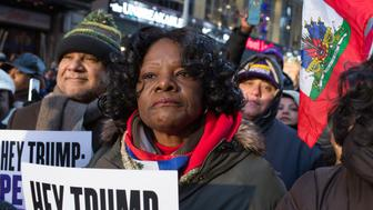 NEW YORK, NY - JANUARY 15: Haitian immigrants mark Martin Luther King Day by attending a rally to protest against President Trump's immigration policies on January 15, 2018 in Times Square in New York City. The President questioned why the United States should accept immigrants from 'shit hole' countries like Haiti. (Photo by Andrew Lichtenstein/ Corbis via Getty Images)
