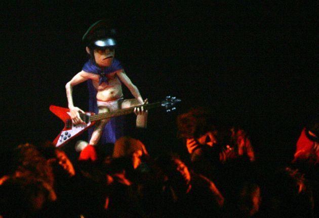 A hologram figure of virtual British group Gorillaz is projected on stage during their performance at...