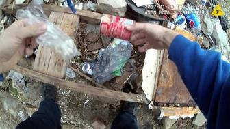 A body camera video appears to show Baltimore police officer Richard Pinheiro Jr placing a bag inside a can