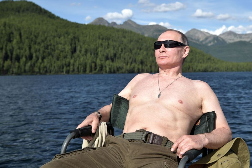 Russian President Vladimir Putin relaxes during a hunting and fishing trip on Aug. 1-3, 2017, in the republic of Tyva in
