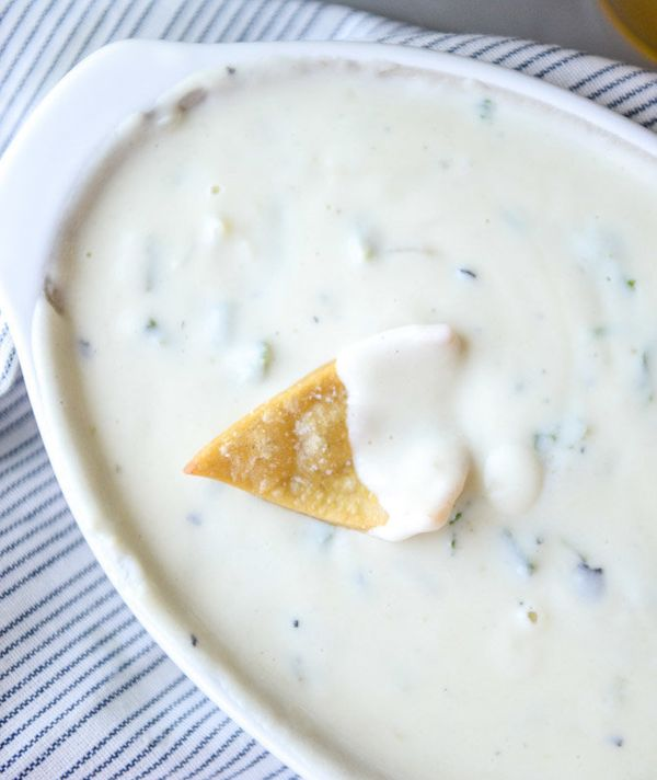 "<strong>Get the <a href=""https://www.howsweeteats.com/2015/09/roasted-green-chile-queso-cheese-dip/"" target=""_blank"">Roasted"