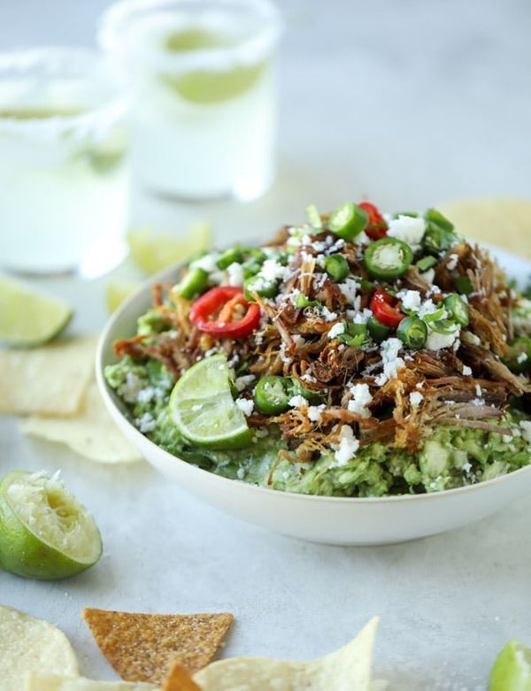 "<strong>Get the <a href=""https://www.howsweeteats.com/2017/12/pulled-pork-guacamole/"" target=""_blank"">Crispy Carnitas Guacamo"