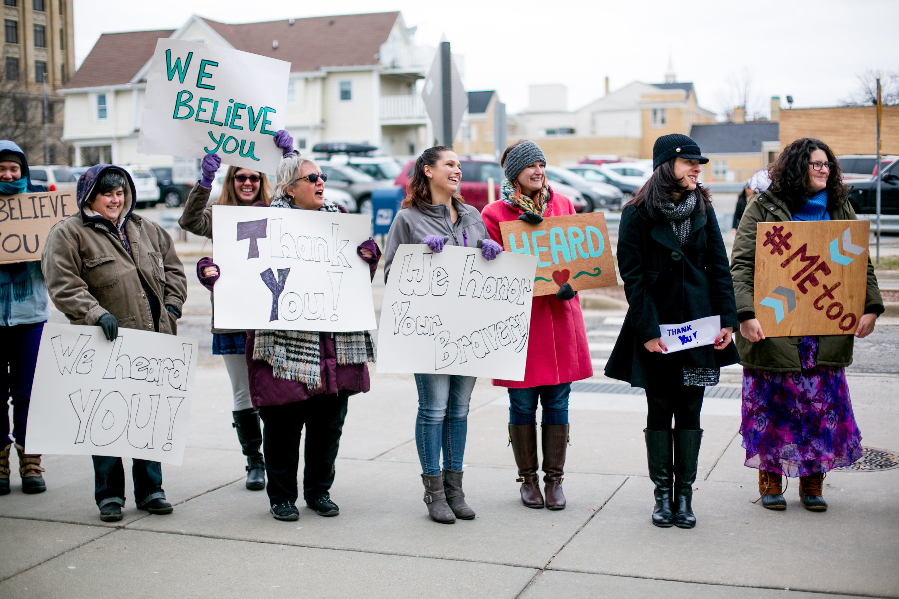 LANSING, MI - JANUARY 24:  Woman from the Michigan based victim advocacy groups End Violent Encounters and Firecracker Foundation cheer for women as they leave the courthouse after the sentencing of the disgraced doctor in Ingham County Circuit Court on January 24, 2018 in Lansing, Michigan. The former USA Gymnastics and Michigan State University Doctor was sentenced to up 175 years in prison for sexually assaulting dozen of girls and women   (Photo by Anthony Lanzilote/Getty Images)