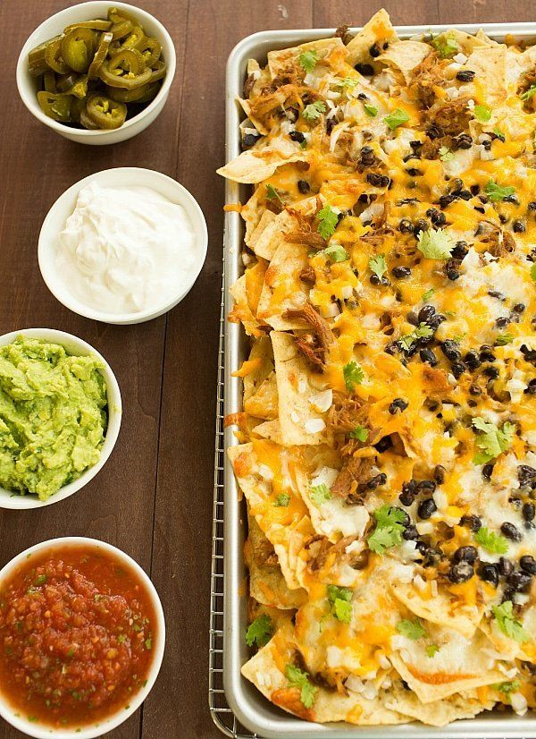 "<strong>Get the <a href=""https://www.browneyedbaker.com/ultimate-nachos-with-beer-braised-carnitas/"" target=""_blank"">Ultimate"