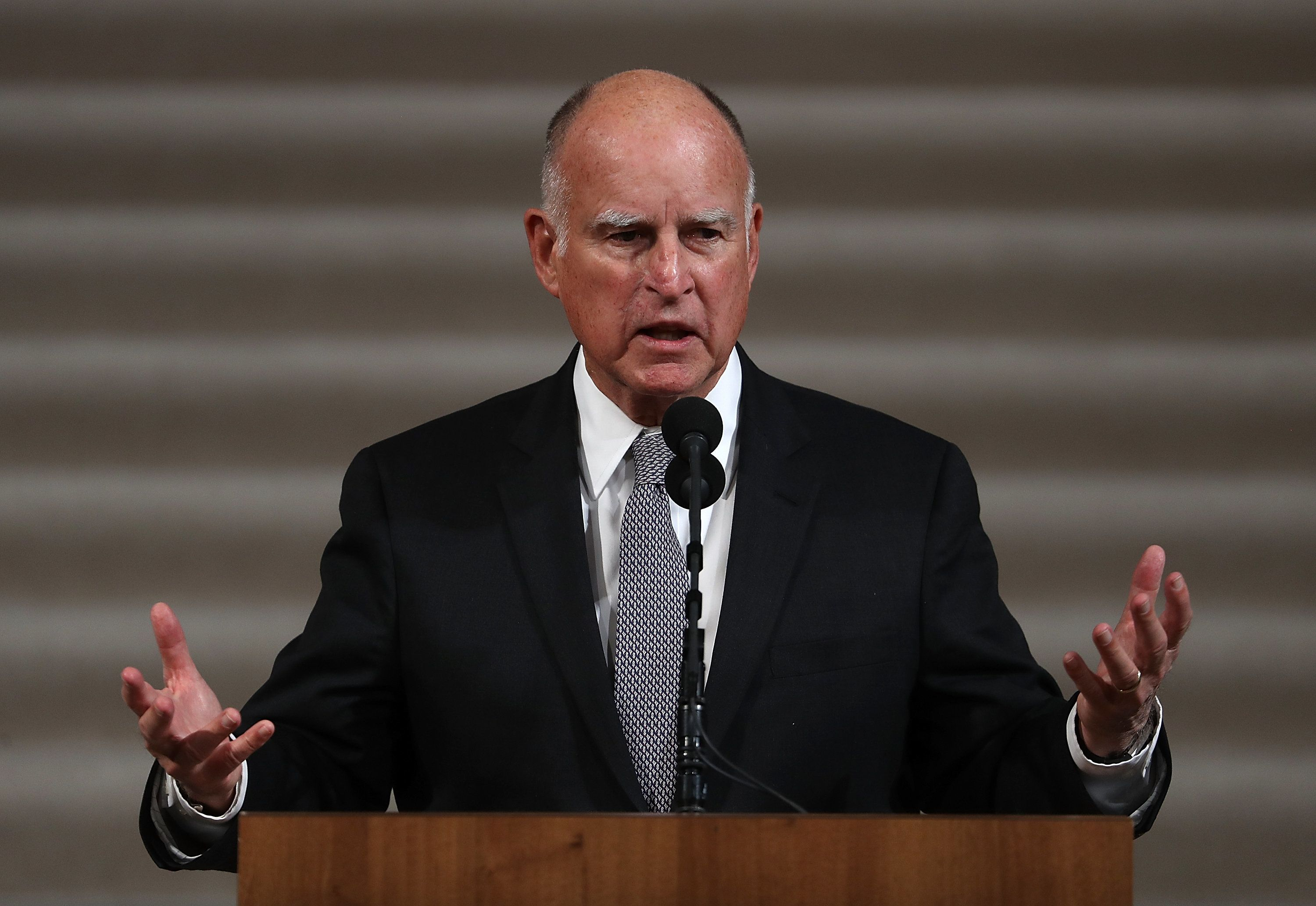 SAN FRANCISCO, CA - DECEMBER 17:  California Gov. Jerry Brown speaks during a Celebration of Life Service held for the late San Francisco Mayor Ed Lee on December 17, 2017 in San Francisco, California. Hundreds of people attended the service for Lee, who died unexpectedly early Tuesday morning after suffering a heart attack.  (Photo by Justin Sullivan/Getty Images)
