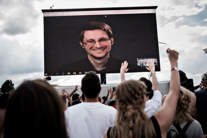 Edward Snowden, seen on a screen as he delivers a speech to a festival in Denmark, was forced to leave the U.S. after he leak
