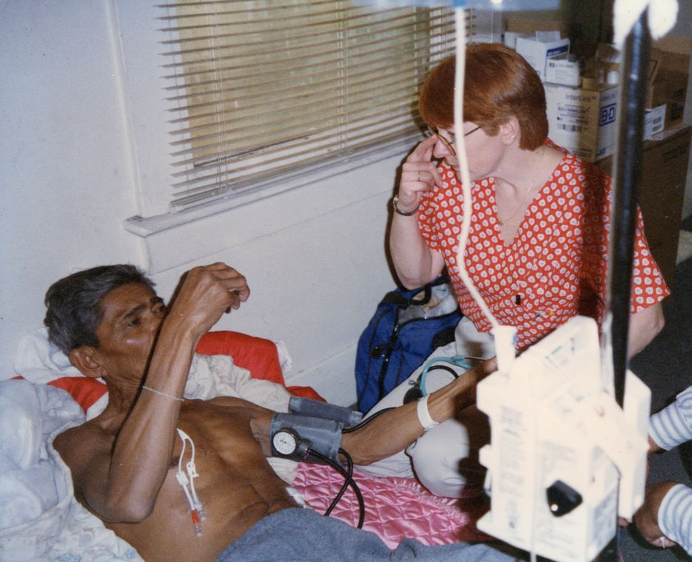 Sok's father is seen with a home nurse in 1997. He died of cancer when Sok was 16.
