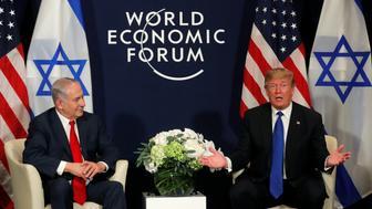 U.S. President Donald Trump speaks with Israeli Prime Minister Benjamin Netanyahu during the World Economic Forum (WEF) annual meeting in Davos, Switzerland January 25, 2018 REUTERS/Carlos Barria