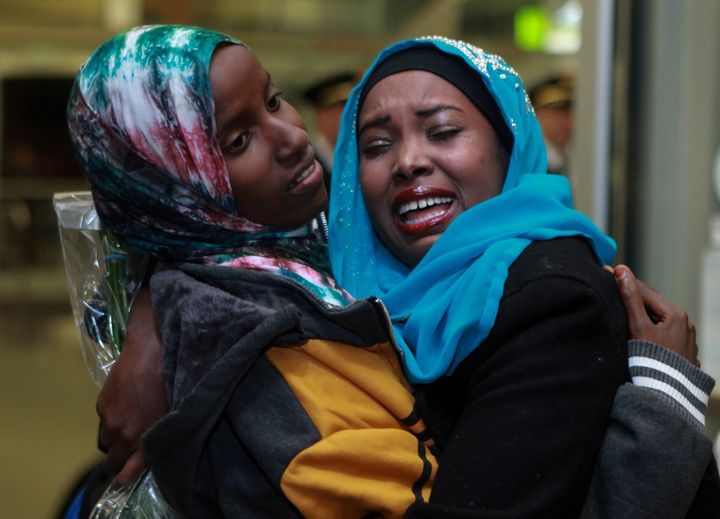 Dahaba Matan (left), a refugee from Somalia, greets her American family members upon arrival at the airport in Bois
