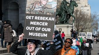NEW YORK, NY, UNITED STATES - 2018/01/21: Protester seen holding placards and chanting slogans during the protest. Protest against Rebekah Mercer being a member of the Board of Trustees of the American Museum of Natural History (AMNH) taking place in front of the American Museum of Natural History in New York city. (Photo by Michael Brochstein/SOPA Images/LightRocket via Getty Images)
