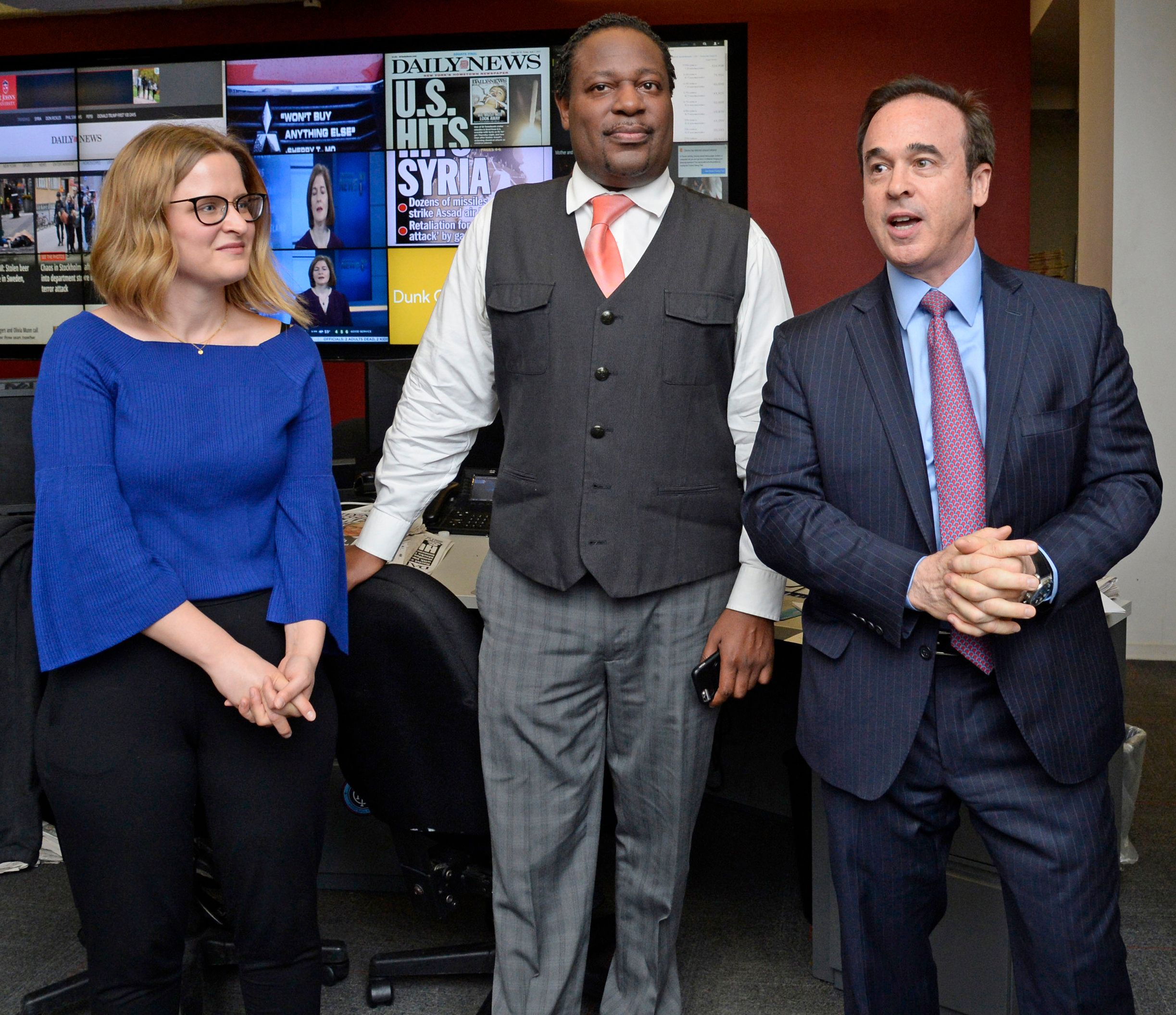 (left-right) Sarah Ryley celebrates receiving a Pulitzer Prize with Daily News News Editor Robert Moore and Co-Chairman and Co-Publisher Eric Gertler on Monday, April 10, 2017. (Photo by Jefferson Siegel/NY Daily News via Getty Images)