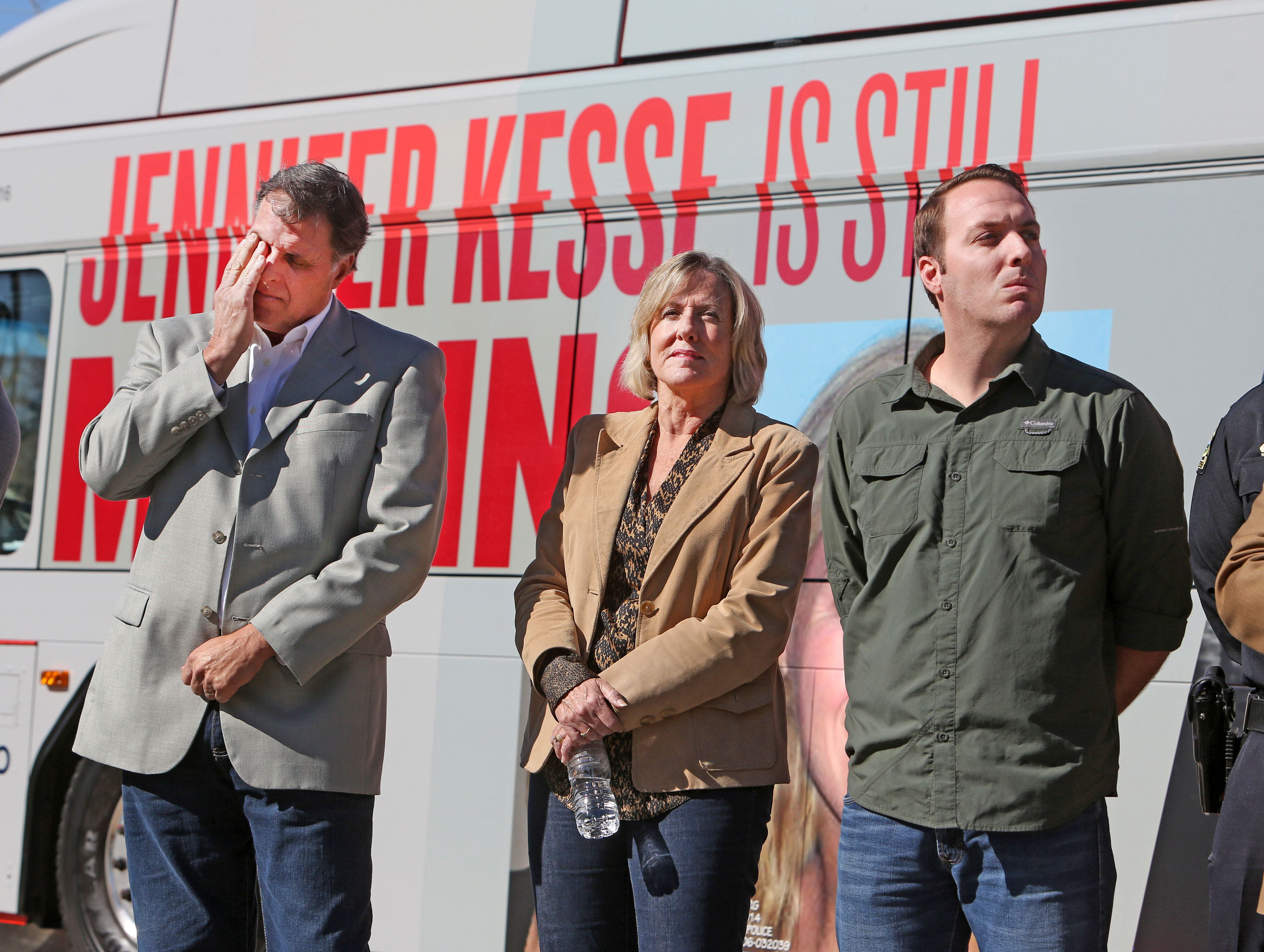The Kesse family, Drew, father, Joyce, mother, and Logan, brother, participate in a news conference on January 24, 2018, marking 12 years since the disappearance of Jennifer Kesse. (Red Huber/Orlando Sentinel/TNS via Getty Images)