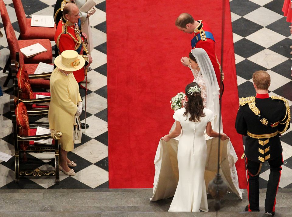 William and Kate bow in front of the Queen and Duke of