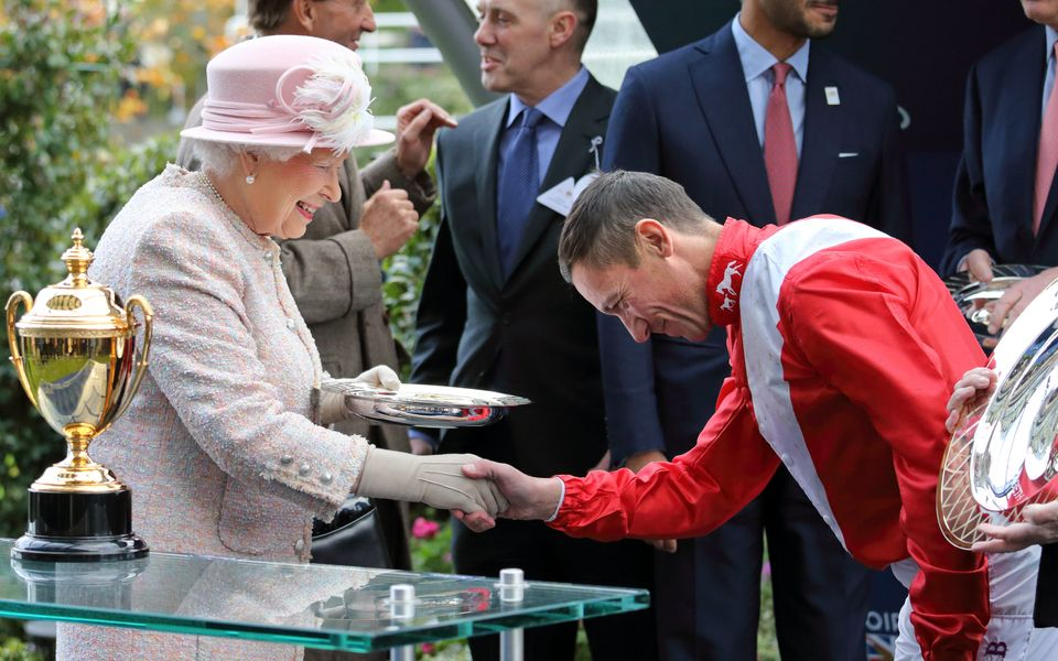 Jockey Frankie Dettori gives a formal handshake to the