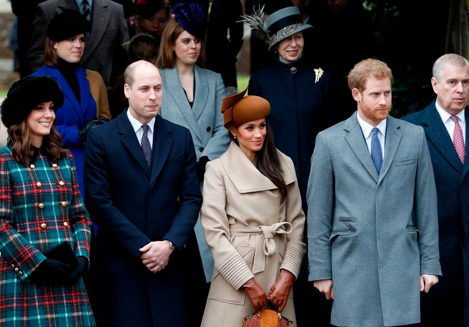 Meghan Markle waits with members of the Royal Family as they wait to see off the Queen after attending...