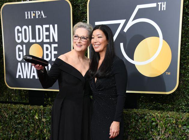 Meryl Streeparrivingat the Golden Globes alongsideAi-jen Poo, the head of the National...