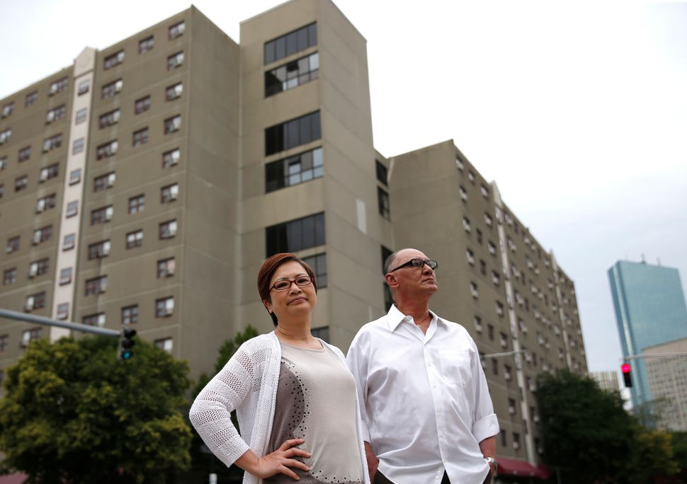 Bill Oranczak and Serene Wong stand in front of Mass Pike Towers.