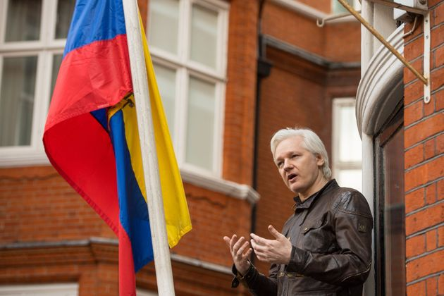 Julian Assange seen speaking from the balcony of the Ecuadorian embassy in