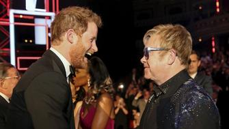 Britain's Prince Harry greets Elton John after the Royal Variety Performance at the Albert Hall in London, November 13, 2015. REUTERS/Paul Hackett - RTS6W6Z