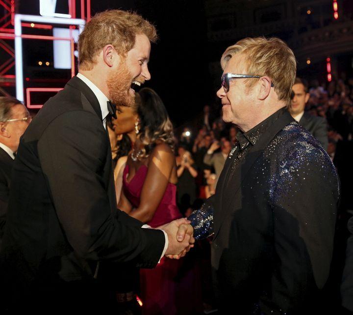 Prince Harry greets Elton John on Nov. 13, 2015.
