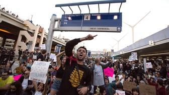 LOS ANGELES, CA - JANUARY 29: Hundreds gather blocking traffic on the arrival level of the Tom Bradley International Terminal to protest Donald Trump's new immigration order at LAX on January 29, 2017 in Los Angeles, California. (Brian van der Brug / LA Times via Getty Images)