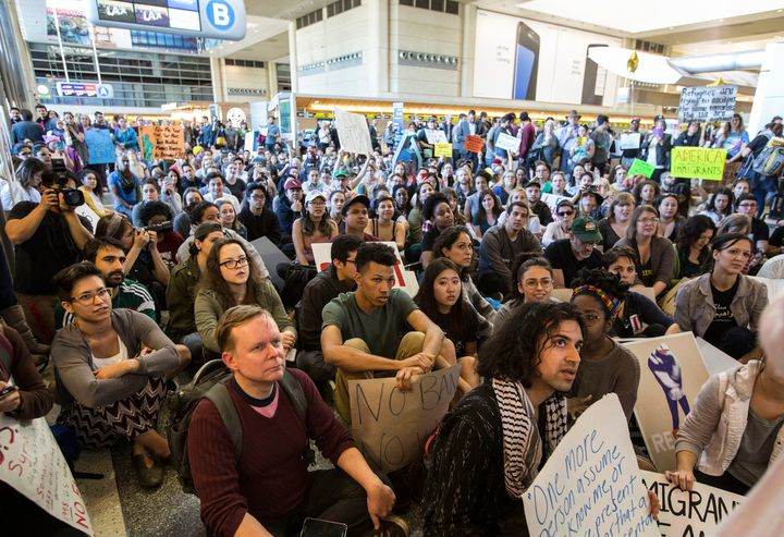 Hundreds sit in on the departure level of the Tom Bradley International Terminal to protest Trump's immigration order at&nbsp