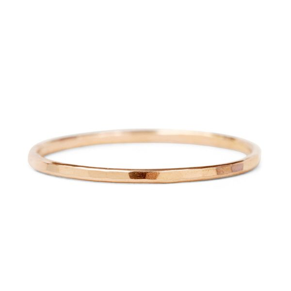 "Get it at <a href=""https://www.catbirdnyc.com/classic-hammered-ring-rose-gold.html"" target=""_blank"">Catbird</a>."