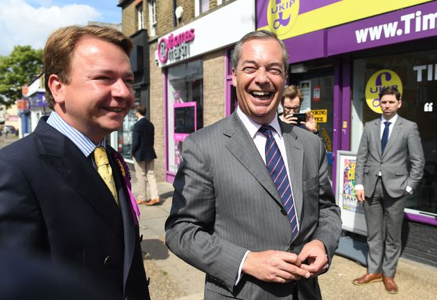 Tim Aker (left) is among those to have quit the party. He is picturedon the campaign trail withNigel...