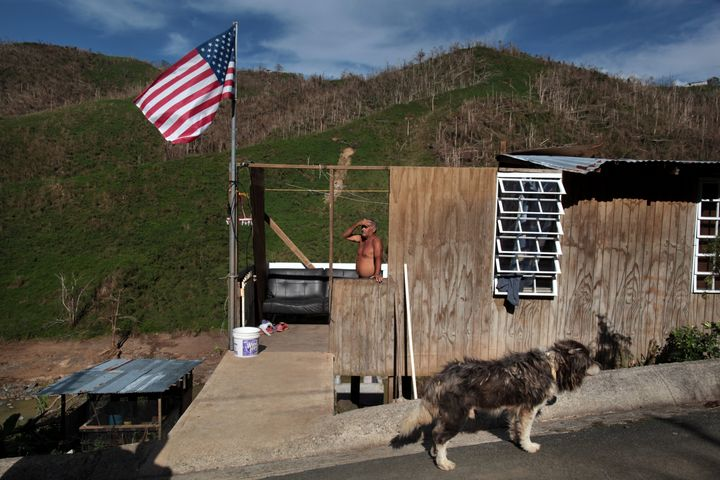 Ismael Rivera stands at his damaged house in San Lorenzo, Puerto Rico, on Oct. 4, 2017.