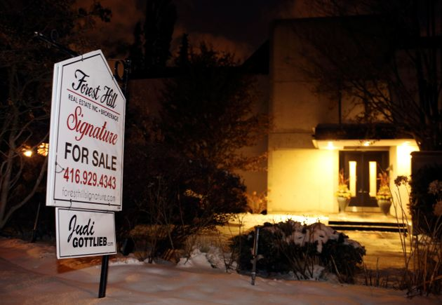 A for sale sign stands outside the Sherman's former home where they were found dead in