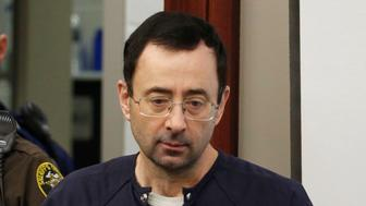 Former Michigan State University and USA Gymnastics doctor Larry Nassar arrives for impact statements during the sentencing phase in Ingham County Circuit Court on January 24, 2018 in Lansing, Michigan. More than 100 women and girls accuse Nassar of a pattern of serial abuse dating back two decades, including the Olympic gold-medal winners Simone Biles, Aly Raisman, Gabby Douglas and McKayla Maroney -- who have lashed out at top sporting officials for failing to stop him.    / AFP PHOTO / JEFF KOWALSKY        (Photo credit should read JEFF KOWALSKY/AFP/Getty Images)