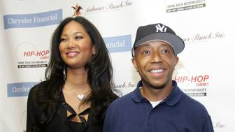 "Russell Simmons (R), Chairman and CEO of Rush Communications, and his wife Kimora Lee Simmons pose before taking  part in the ""Get your Money Right"" Hip Hop Summit in Detroit, Michigan March 25, 2006. REUTERS/Rebecca Cook"