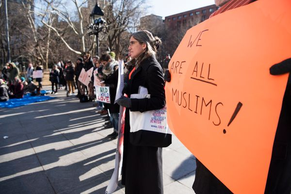 Allies make a circle around Muslim's praying in Washington Square Park in Washington Square Park in New York on Jan. 26, 2018