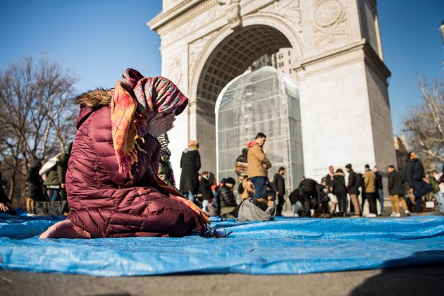 Saima Anjam, senior director of advocacy at the New York Immigration Coalition, prays during a