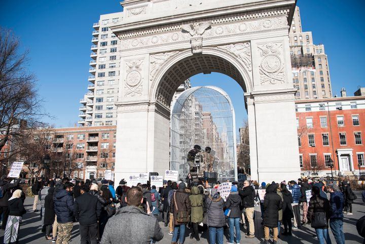 People take part in a prayer and protest at Washington Square Park to mark the anniversary of Trump's first tr