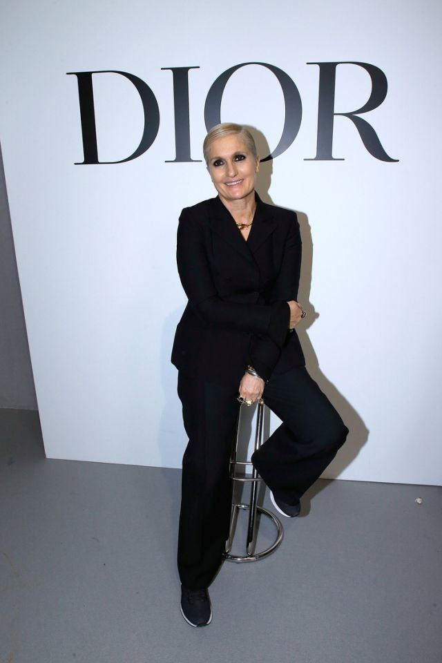 Maria Grazia Chiuri poses after the Christian Dior Haute Couture spring/summer 2018 show on Jan. 22, 2018, during Paris Fashion Week.