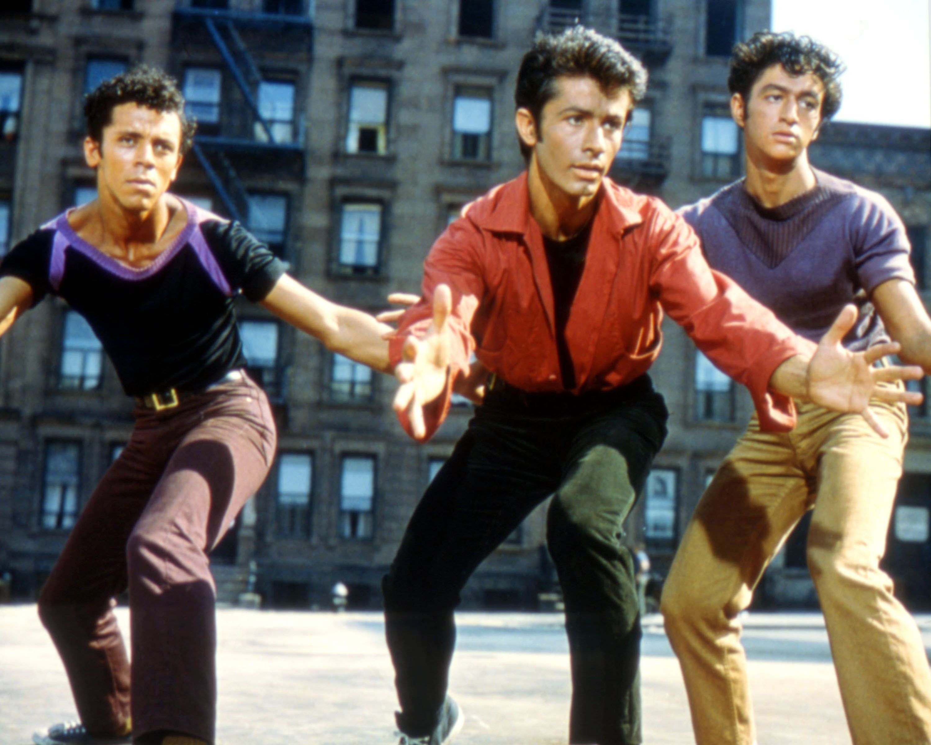 George Chakiris (centre), US actor, in a publicity image issued for the film adaptation of 'West Side Story', USA, 1961. The musical, directed by Jerome Robbins (1918-1998) and Robert Wise (1914-2005), starred, Chakiris as 'Bernardo Nunez'. (Photo by Silver Screen Collection/Getty Images)