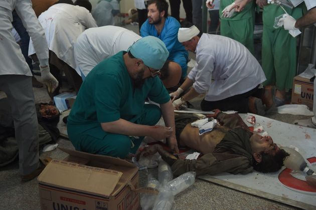 Afghan medical staff treat a wounded