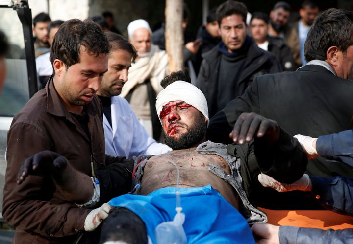An injured man receives medical assistance after a blast in Kabul, Afghanistan on January 27, 2018.