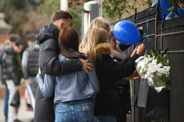 People laid tributes at the scene on Shepiston Lane in Hayes on