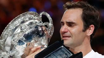 Tennis - Australian Open - Men's singles final - Rod Laver Arena, Melbourne, Australia, January 28, 2018. Winner Roger Federer of Switzerland cries as he holds the trophy. REUTERS/Issei Kato   TPX IMAGES OF THE DAY