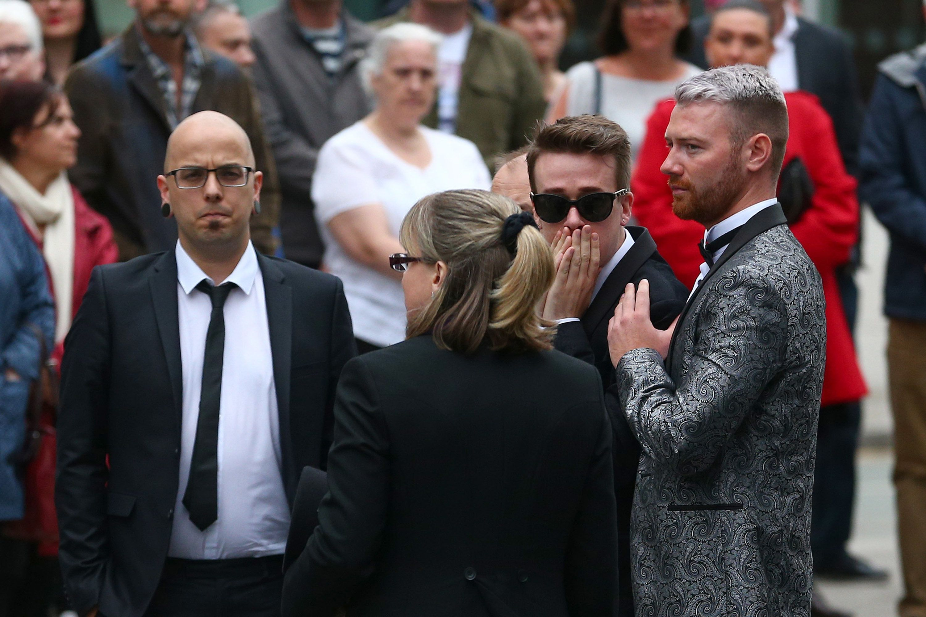 <strong>Dan Hett (far left) and at brother Martyn Hett's funeral at Stockport Town Hall.</strong>