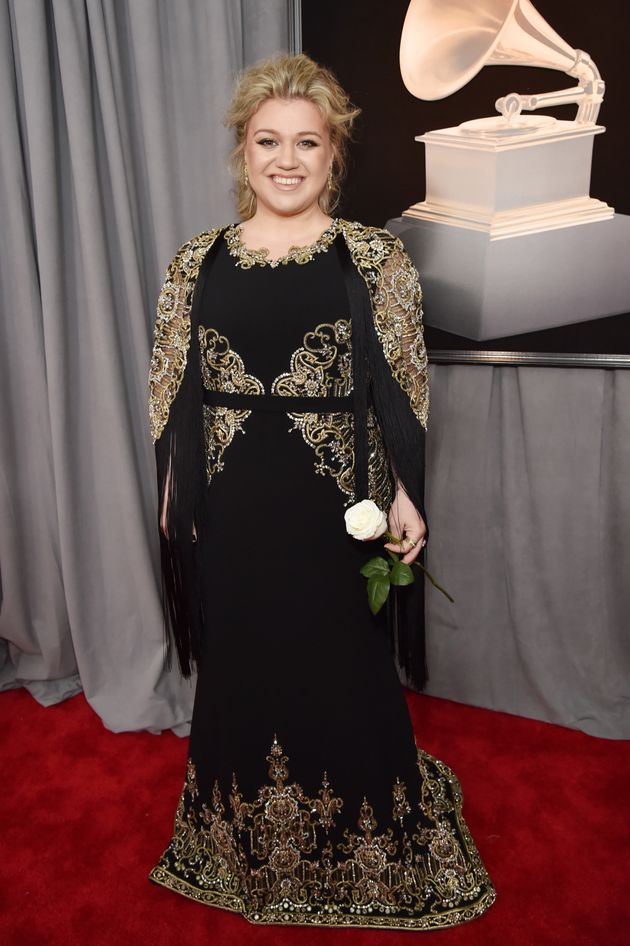 Kelly Clarkson carrying her white rose at the 60th annual Grammy Awards on Jan.