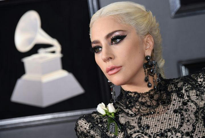 Lady Gaga wears a white rose in support of the Time's Up initiative at the Grammys.